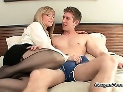 Amazing blonde Cougar slut with big breasts and sexy body looks