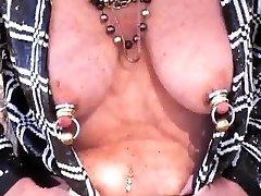 Mature Wiggles Heavily jeweled tits
