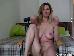 Cougar with giant boobs rubs her mature pussy
