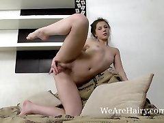Dea Ishtar takes off and models her bare body