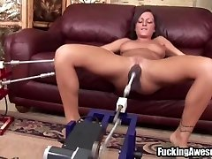Busty dark haired plays with fucking machine