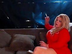 Busty blonde smoking