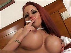 Sexy massive tit smoking redhead masturbating