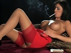 Hot Sexy Buxom Brunette In High-heeled Slippers Smoking and Playing
