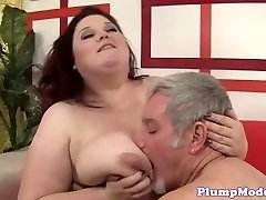 Redhead BBW with immense funbags gets screwed