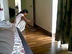 Maid showcasing Cleavage