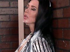 Muddy bitch sucking huge sex toy thru the gloryhole