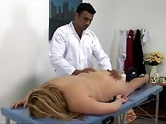 Massive blonde lady gets fucked on the massage table