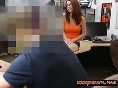 Big-boobed redhead girl in eye glasses gets fucked in a pawnshop