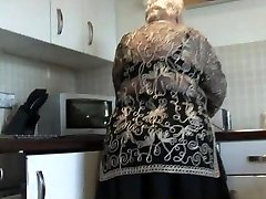 Sweet grandma demonstrates hairy pussy big ass and her udders