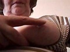 Sexy hairy granny in mini microskirt