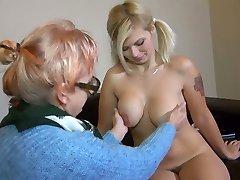 Elder ugly slut in glasses Bernadett tickles fresh pussy of pigtailed busty gal
