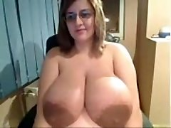 Ugly Chick flashes off insanely massive tits