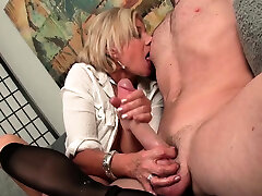 Stockinged mature jerking dick until cumshot