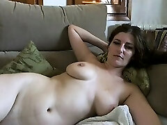 Busty mature brunette with huge boobs and hairy cooter strips