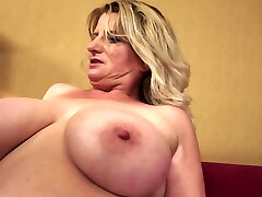 Chubby Grannie Undresses And Show Tits