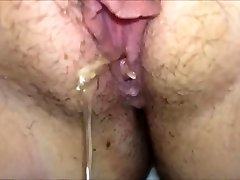 Busty amateur jerking meaty cock by the pool