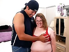 Sexy mature BBW Lorelie shows off her big fat breasts to lure a hunk into lending her his huge...