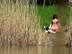 Couple fuck bear the river