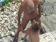 old & young gay-for-pay bottom nudist at the beach