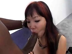 Little Asian taking immense black cock
