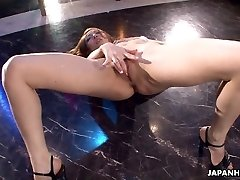 Japanese stripper getting wild on the pole as she wanks