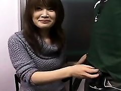 Sexy Japanese babe with a pretty smile works her palms on a