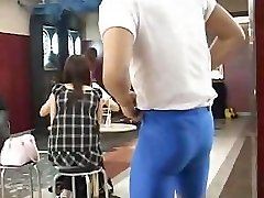 Muscular fellow flashes highly cute busty Japanese chick in a bar