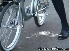 College Girl Drizzles on a Bike in Public!
