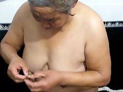 Asian granny in the bath