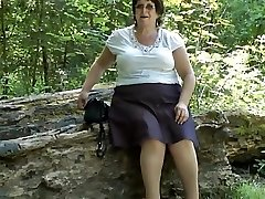 Upskirt bootie in the woods part two