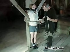 Tied to a pole blonde gets her shaven honeypot punished