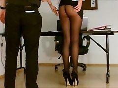 Secretary pantyhose exposed.