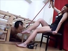 Caged Japanese foot victim worships her mistress