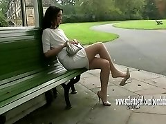 Pretty babe shows off her silky sleek nylon legs and posh high heels