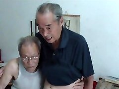 Chinese old men comparing cocks