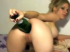 Crazy blonde uses the thick end of a bottle to stick in her culo