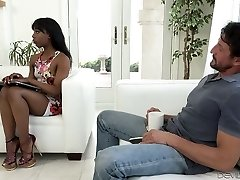 Sexy black chick wanks and blows ginormous white hard-on on the couch