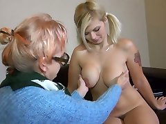 Old ugly bitch in glasses Bernadett tickles fresh pussy of pigtailed buxom gal