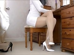 Nymph Tan Pantyhose legs and white shoes .