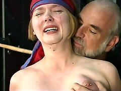 Cute young light-haired with perky tits is restrained for nipple clamp play