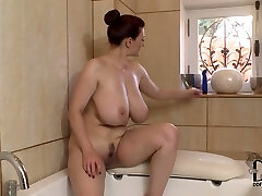 Well stacked brunette milf dildo fucks her cleavage in the bath room