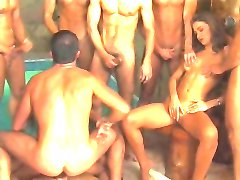 Group sex beside the pool