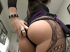 Lustful brunette wearing crotchless pantyhose peels off on a camera