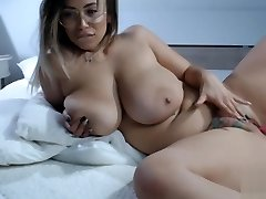 Romanian chubby mature playing her tattoo pussy on bed
