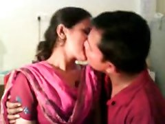 couple smooching and friend recorded