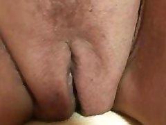 Sexy granny sucks and tugs two cocks