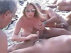Nude Beach - Public Handjobs with Pierced Nipples