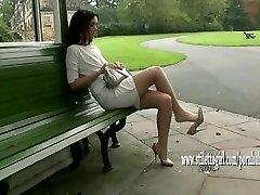 Pretty babe shows off her velvety sleek nylon legs and posh high heels