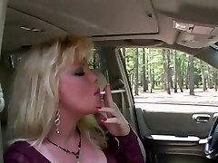Sizzling Blonde MILF Smoking & Fellating In Fishnets & Heels